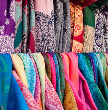 Beautiful, handmade colourful scarves sold at a local market