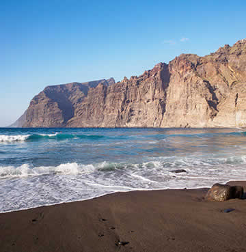 Los Gigantes Beach and towering cliffs against black sands