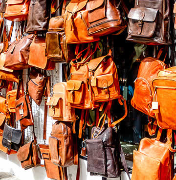 Leather bags hanging at a local Spanish market