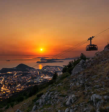 Cable car travelling down from the top of Mount Srđ at sunset
