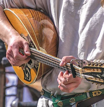 Man playing Traditional Mandolin at Greek festival