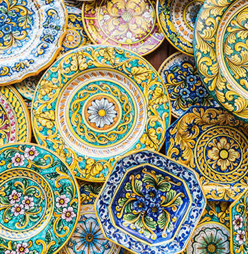 Traditional, brightly-coloured and heavily-patterned Caltagirone pottery in Sicily
