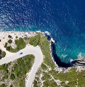 A winding coastal road on the Kefalonian coastline