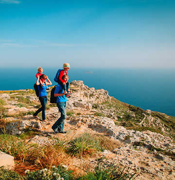 A young family out walking on the Dingli Cliffs, Malta