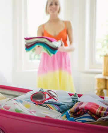 A lady packing her holiday clothes