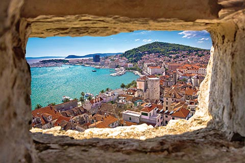 A view of Split harbour, Croatia, through a stone opening
