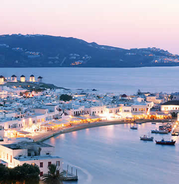 Mykonos Town as the sun sets and the party scene begins to liven up