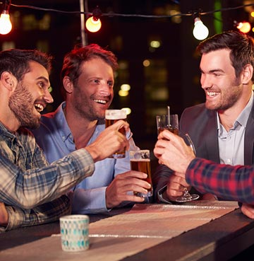 Three men drinking together in a bar