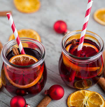 Traditional Sorrel Punch from Jamaica, displayed on a table decorated with Christmas baubles