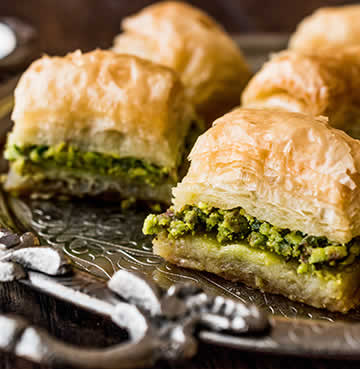 Layers of delicate filo pastry and honey-soaked nuts make the iconic Grecian desert of Baklava