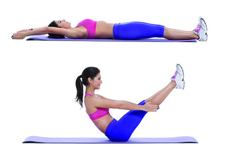 Woman performing leg lift crunches