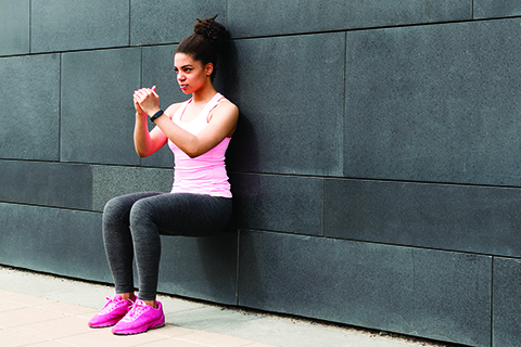 Woman performing wall squat