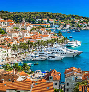 Luxury yachts are moored by the harbour front of Hvar Town