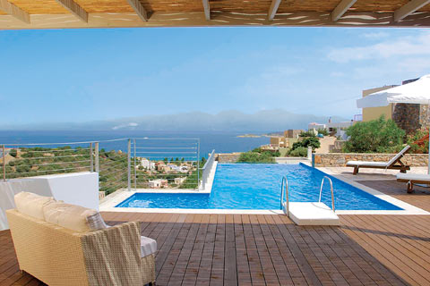 An infinity pool and decking overlooking the Mirabello Gulf in Crete