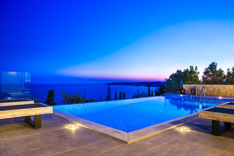 An infinity pool in Kefalonia, Greece, at sunset