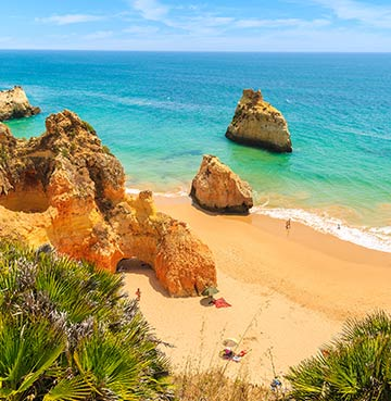 Golden beach and craggy cliffs in the Algarve