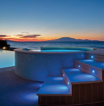 Luxury hot tub with romantic lighting at sunset in Zakynthos