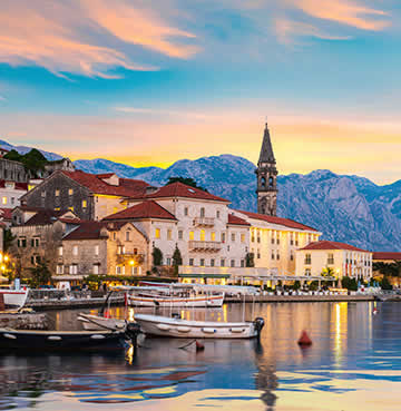 Historic Kotor Old Town backed by brooding mountains in Montenegro