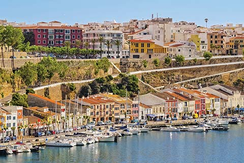 Candy-coloured houses line the waterfront in Mahon.