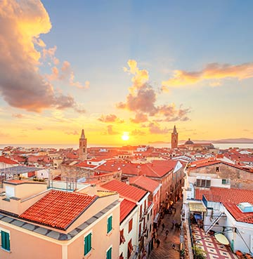 Sunset over the city of Alghero on Sardinia