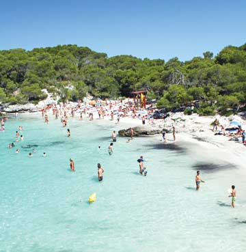 People playing in the sea at Cala Turqueta Beach, Menorca