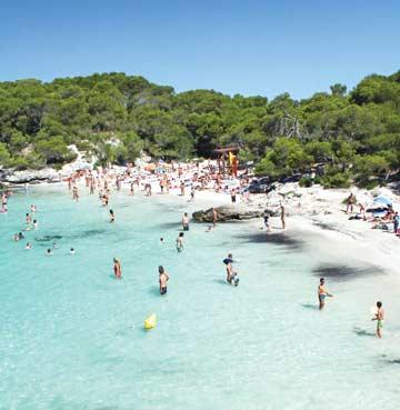 People playing in the sea at Cala Turqueta Beach, Menorca