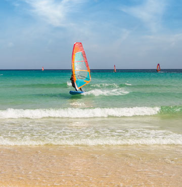 Windsurfing close to the coast on the Canary island of Fuerteventura