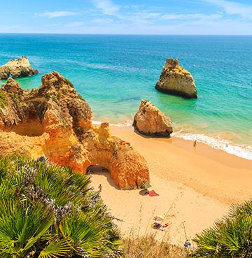 Golden sands and turquoise waters at a beautiful beach in the Algarve