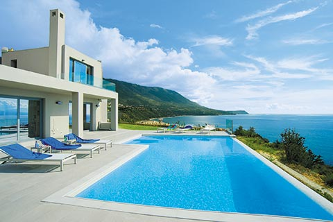A modern infinity pool overlooking the ocean in Kefalonia, Greece