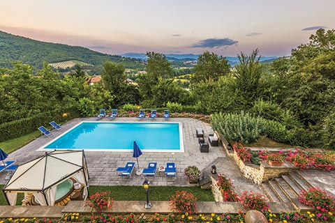 A beautiful Italian terrace and private pool overlooking the Tuscan countryside