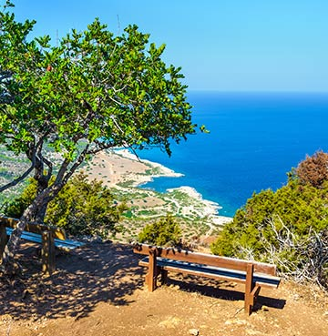 Empty bench at the cliff edge, positioned to enjoy the views at Akamas Peninsula