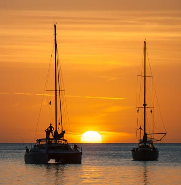 View of the sunset and boats on the ocean in St. Lucia