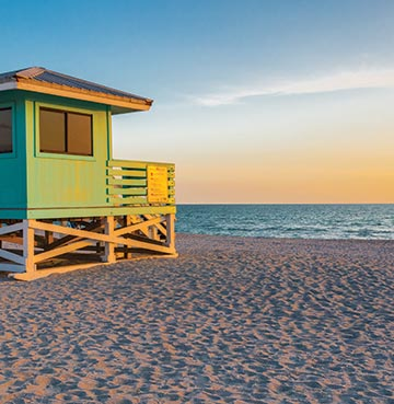 White sands, blue seas and a lifeguard hut at sunset on Venice Beach