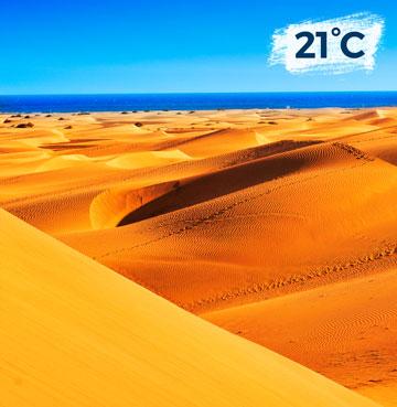 Golden sand dunes meet the horizon on Gran Canaria