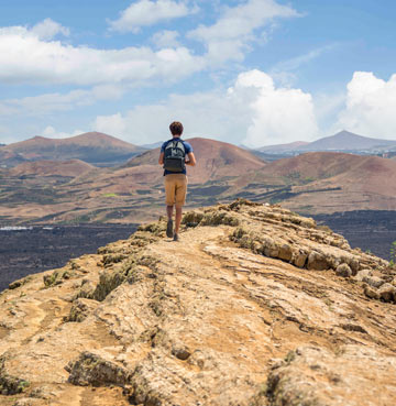 Hiking across the beautiful mountains of Lanzarote