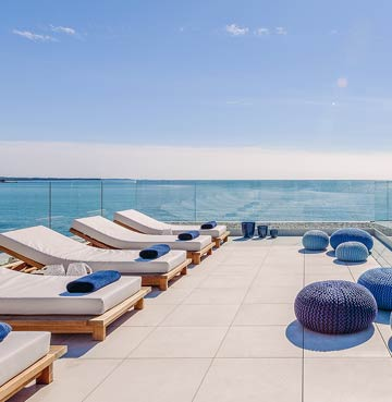 Elegant terrace with luxury sunloungers looking out to sea in Istria, Croatia