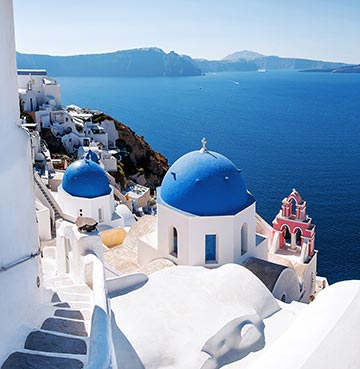 Iconic blue domed churches in Santorini, Greece