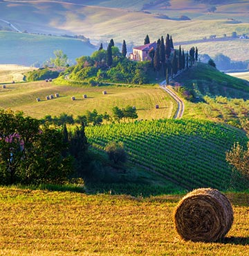 Rolling hills and farmers fields of Tuscany, Italy