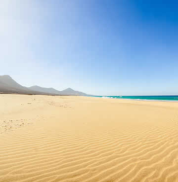 The stunning sand dunes of Corralejo Beach, Fuerteventura