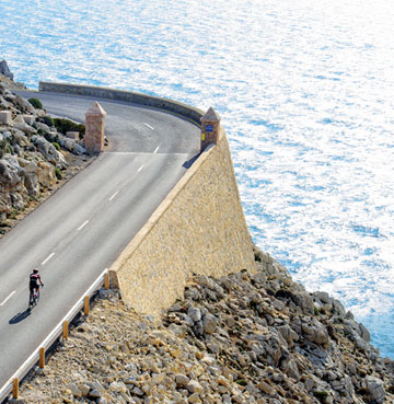 Cyclist on a challenging uphill road, Mallorca