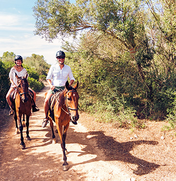 View of a couple horse riding in Menorca