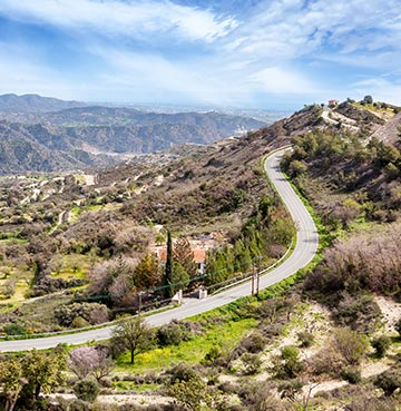 A windy road meanders through the beautiful Troodos Mountains