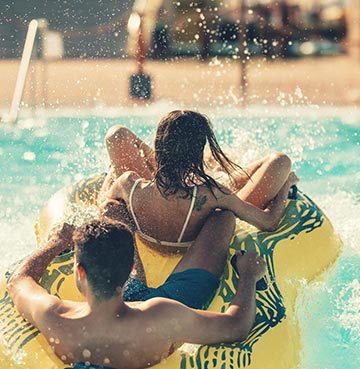 Children getting splashed riding a rubber dinghy at Aphrodite waterpark