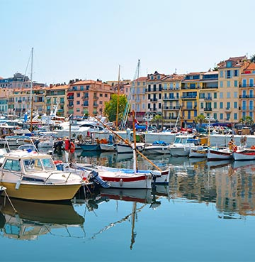 Picturesque boats and colourful buildings in Cannes harbour, South of France
