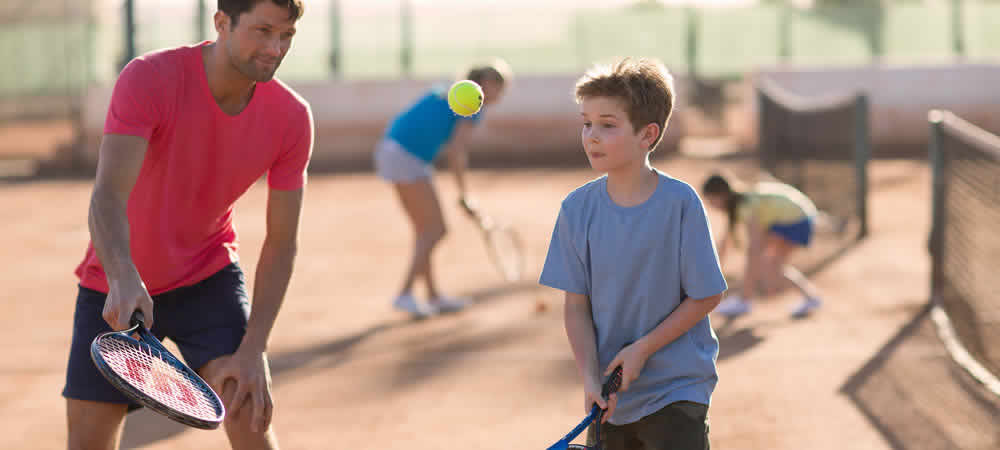 A family playing tennis at a Holiday Resort