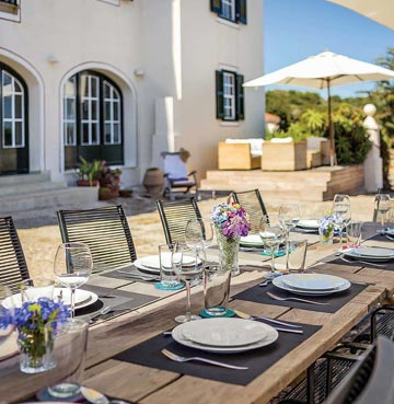Outdoor dining table in villa Binigaus Nou, Menorca