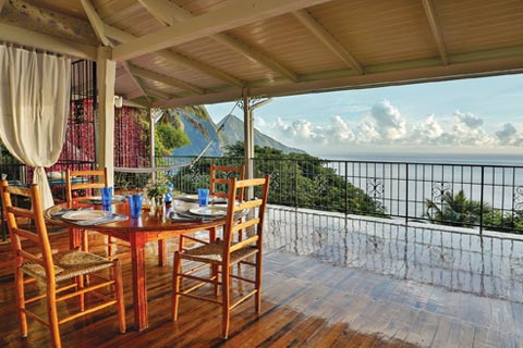 An open living area looks out over the Pitons in Soufriere, St. Lucia