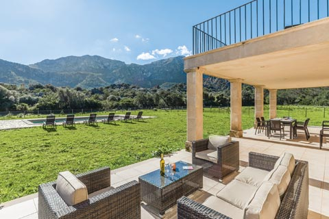 A spacious terrace, garden and pool area are overlooked by brooding mountains on the Balearic Island of Mallorca