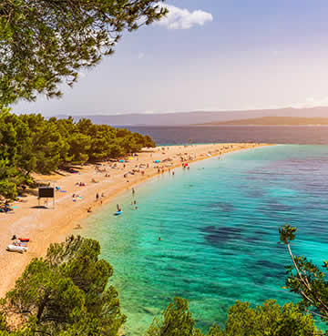 Fine golden pebbles and happy holidaymakers at Zlatni Rat, Brac