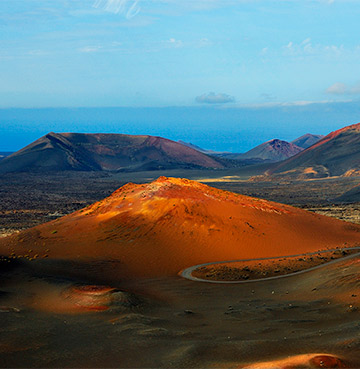 Aerial view of Timanfaya National Park and Fire Mountains looking out to sea